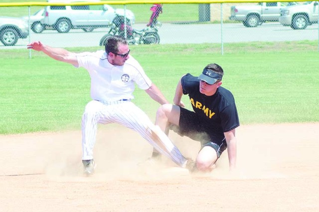 Second Lt. Zachary Holder, 716th Military Police Battalion, 101st Airborne Division Sustainment Brigade, 101st Airborne Division, confidently slid into second base during the sixth annual Warrior Week Tobacco Stick Softball Game May 7 at Heritage Park. The team comprised of active-duty Soldiers and spouses swept the game against Clarksville, 30-4. Fort Campbell now leads the Tobacco Stick series 4-2.