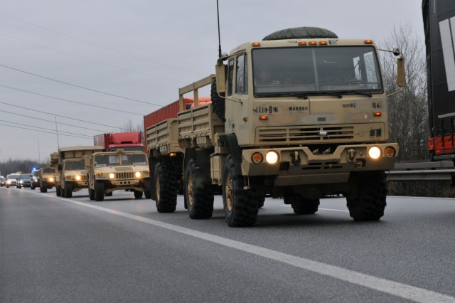 BERGEN-HOHNE, Germany - Soldiers assigned to 3rd Armored Brigade Combat Team, 4th Infantry Division, out of Fort Carson, Colorado drive an Army M1078 LMTV tactical vehicle and several other military vehicles during a convoy to Poland for their nine-month deployment training along side multinational partners, Jan. 9.  The 3-4 ABCT's arrival marks the start of back-to-back rotations of armored brigades in Europe as part of Atlantic Resolve. This rotation will enhance deterrence capabilities in the region, improve the U.S. ability to respond to potential crises and defend allies and partners in the European community. U.S. forces will focus on strengthening capabilities and sustaining readiness through bilateral and multinational training and exercises. (Photo by Staff Sgt. Elizabeth Tarr)