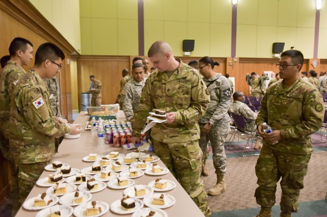 Staff Sgt. Hicks enjoys refreshments after the National American Heritage Month Observance.