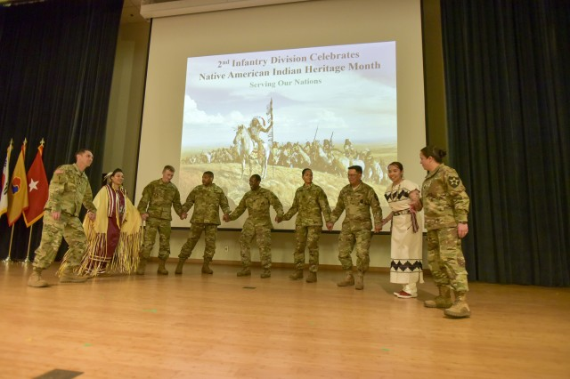 Soldiers dance the traditional Indian dance at the end of the National American Indian Heritage Month Observance.