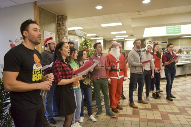 Diana Degarmo and the cast of Jekyll and Hyde sings Christmas Carols during brunch to share a bit of home with Families in Area IV at the Sustainer Grill on December 19.