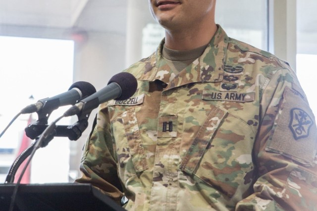Capt. Michael E. Buzzell, incoming commander, Headquarters and Headquarters Company, U.S. Army Intelligence and Security Command, gives remarks during the INSCOM HHC change of command ceremony at Fort Belvoir, Virginia, Dec. 14.  Buzzell officially assumed command of the company supporting INSCOM's operations from Capt. Geoff M. Terman. (U.S. Army Photo by Tani Murphy)