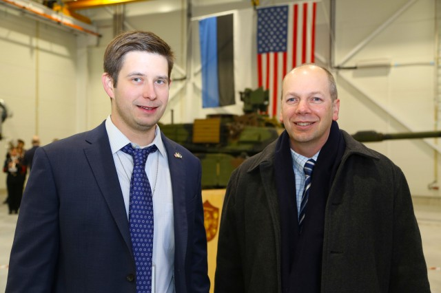 Chris Bailey, left, the U.S. Army Corps of Engineers Europe District project engineer in Estonia, takes part in a Dec. 15 ceremony marking the completion of 27 European Reassurance Initiative projects for U.S. Army Europe at Tapa Military Base in Estonia. The projects are designed to support training and readiness of NATO, U.S. and Estonian forces.