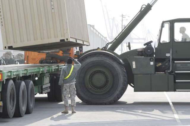 19th ESC Soldiers load a 1-6 Heavy Attack Reconnaissance Squadron Rotation cargo on a truck to be transported to the 2ID at Camp Humphreys.