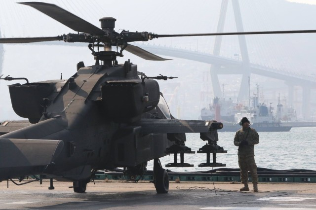 A 2ID Soldier checks if there is any malfunction in the helicopter before it takes off straight to Camp Humphreys.