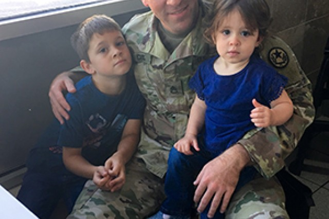 Texas Army National Guard Staff Sgt. Dias, recruiting and retention officer for the Recruiting and Retention Battalion, enjoys lunch with his six-year-old son Gavin, left, and 18-month-old Aeryn, right, at a restaurant Nov. 12, 2016, in Tyler, Texas. Dias is responsible for rendering aid and saving the life a blind pedestrian who was struck by a vehicle in East Texas.