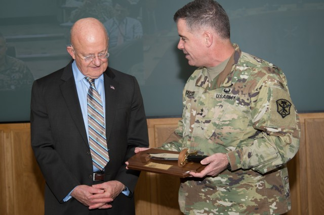 Maj. Gen. Christopher S. Ballard, commanding general, U.S. Army Intelligence and Security Command (INSCOM), presents Director of National Intelligence James R. Clapper with a memento during his visit to INSCOM, Jan. 4. (U.S. Army Photo by Jocelyn M. Broussard)
