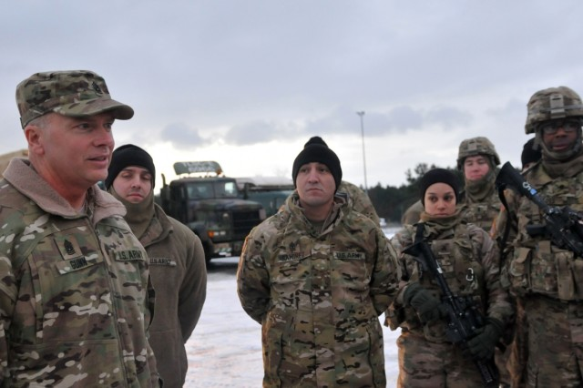 Command Sgt. Major Christopher Gunn, senior noncommissioned officer assigned to 3rd Armored Brigade Combat Team, 4th Infantry Division gives his Soldiers a safety brief before conducting the final day of their convoy crossing into Poland from Germany, Jan. 12, for their nine-month deployment training alongside multinational partners. 3-4 ABCT's arrival marks the start of back-to-back rotations of armored brigades in Europe as part of Atlantic Resolve. This rotation will enhance deterrence capabilities in the region, improve the U.S. ability to respond to potential crises and defend allies and partners in the European community. U.S. forces will focus on strengthening capabilities and sustaining readiness through bilateral and multinational training and exercises. (Photo by Staff Sgt. Elizabeth Tarr)