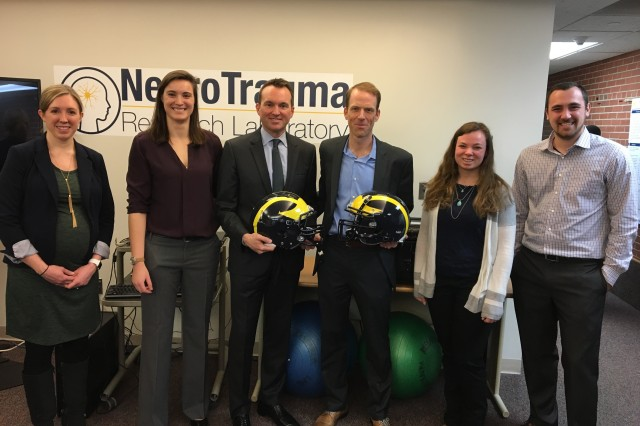 Secretary of the Army Eric Fanning poses for a picture with members of the NCAA-DoD Grand Alliance: Concussion Assessment, Research and Education (CARE) Consortium which offers the promise of a large-scale, multi-site study of the natural history of concussion in both sexes and multiple sports.