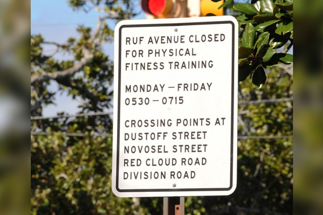One of the signs posted along Ruf Avenue listing when the road is closed to help keep Soldiers conducting physical training safe.