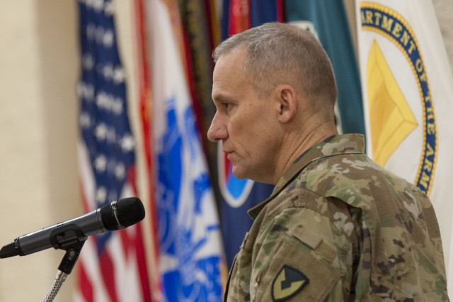 Col. Doyle Lassitter, commander, Distribution Management Center, U.S. Army Sustainment Command, speaks during the ASC Headquarters and Headquarters Company change of command ceremony in Heritage Hall, Rock Island Arsenal, Illinois, Jan. 12.
