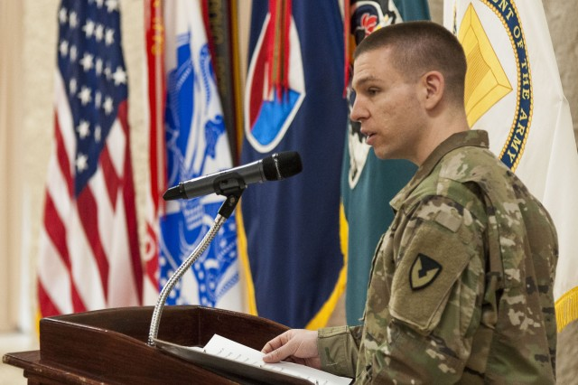 Capt. Michael Rear, outgoing commandant, U.S. Army Sustainment Command's Headquarters and Headquarters Company, speaks during the ASC HHC change of command ceremony in Heritage Hall at Rock Island Arsenal, Illinois, Jan. 12.