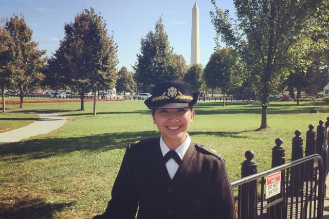 U.S. Army Maj. Beatriz Florez from the 4th Sustainment Command (Expeditionary) out of San Antonio, Texas, poses for a photo in front of the Washington Monument. Florez is chief of Supply and Services, JTF-NCR - 58th Presidential Inauguration.