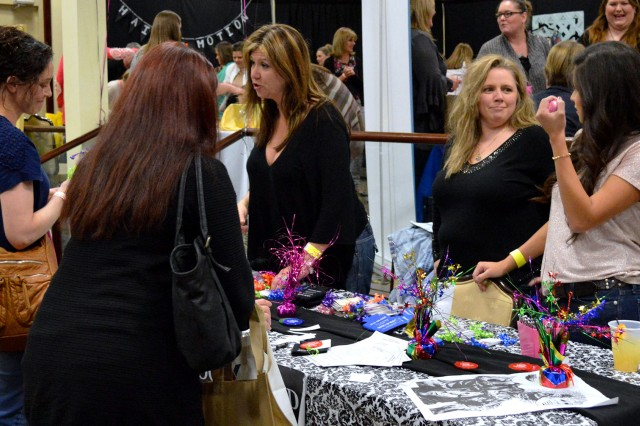 Ladies browse various booths during Girls Night Out at The Landing ballroom last year.