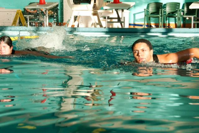 Participants perform a retrieval swim after entering the water with a flotation device during a previous lifeguard certification course.