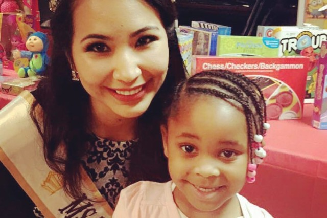 U.S. Army Maj. Beatriz Florez, a McAllen, Texas native and current pageant winner of the Miss Texas Belleza Latina 2016, is shown at a recent Disabled American Veterans' Children's Christmas Party. Florez is also Supply and Services chief for the Joint Task Force-National Capital Region preparing for the 58th Presidential Inauguration.