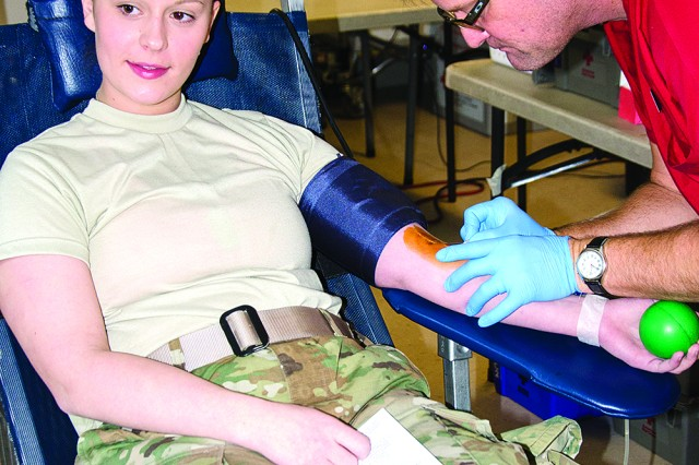 Specialist Hannah Cherry, a human resources specialist assigned to the 101st Airborne Division Sustainment Brigade, 101st Airborne Division, prepares to donate blood Tuesday at a blood drive on Fort Campbell. According to the Red Cross blood drives on Fort Campbell donated 1,508 pints of blood in 2016.