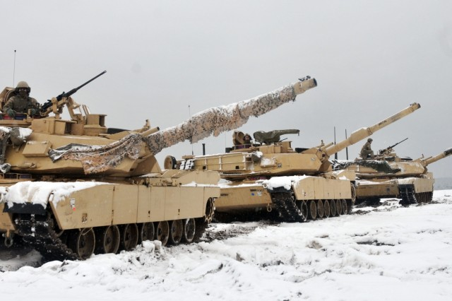 Three M1A2 Main Battle Tanks are staged prior to Soldiers assigned to 1st Battalion, 68th Armor Regiment, 4th Infantry Division conducting the first Live Fire Accuracy Screening Tests at Presidential Range in Swietozow, Poland, January 16, 2017. The arrival of 3rd ABCT 4th ID marks the start of back-to-back rotations of armored brigades in Europe as part of Atlantic Resolve. The vehicles and equipment, totaling more than 2,700 pieces, were shipped to Poland for certification before deploying across Europe for use in training with partner nations. This rotation will enhance deterrence capabilities in the region, improve the U.S. ability to respond to potential crises and defend allies and partners in the European community. U.S. forces will focus on strengthening capabilities and sustaining readiness through bilateral and multinational training and exercises. (Photo by Staff Sgt. Elizabeth Tarr)