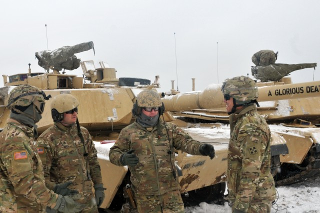 Sgt. 1st Class Matthew Venn, platoon sergeant assigned to 1st Battalion, 68th Armor Regiment, 4th Infantry Division speaks to his Soldiers before firing M1A2 Main Battle Tanks during the first Live Fire Accuracy Screening Tests at Presidential Range in Swietozow, Poland, January 16, 2017. The arrival of 3rd ABCT 4th ID marks the start of back-to-back rotations of armored brigades in Europe as part of Atlantic Resolve. The vehicles and equipment, totaling more than 2,700 pieces, were shipped to Poland for certification before deploying across Europe for use in training with partner nations. This rotation will enhance deterrence capabilities in the region, improve the U.S. ability to respond to potential crises and defend allies and partners in the European community. U.S. forces will focus on strengthening capabilities and sustaining readiness through bilateral and multinational training and exercises. (Photo by Staff Sgt. Elizabeth Tarr)