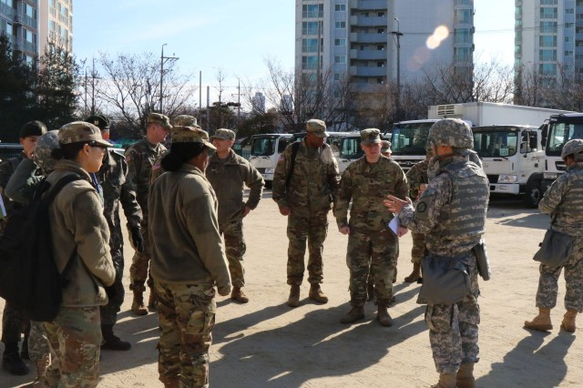 Commander Song Hwan Yun, 32nd KSC Company, KSC Battalion, explains the wartime host nation support (WHNS) exercise aspect to US Army and ROK Army personnel at Daebong Elementary School, Daegu, Jan. 11