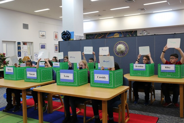 Ten Arnn student competitors hold up dry-erase boards with their answers during Arnn Elementary's 28th annual school-wide National Geographic Bee held Jan. 13 inside the school's information center. (U.S. Army Photos by Noriko Kudo)