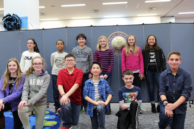 Ten student competitors and two alternates take a group photo during Arnn Elementary's 28th annual school-wide National Geographic Bee held Jan. 13 inside the school's information center. (U.S. Army Photos by Noriko Kudo)