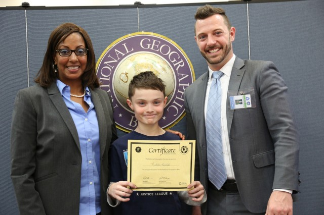 Arnn Elementary sixth-grader, Rushton Kovaleski, is recognized by the judges as winner of the 28th annual school-wide National Geographic Bee held Jan. 13 inside the school's information center. (U.S. Army Photos by Noriko Kudo)