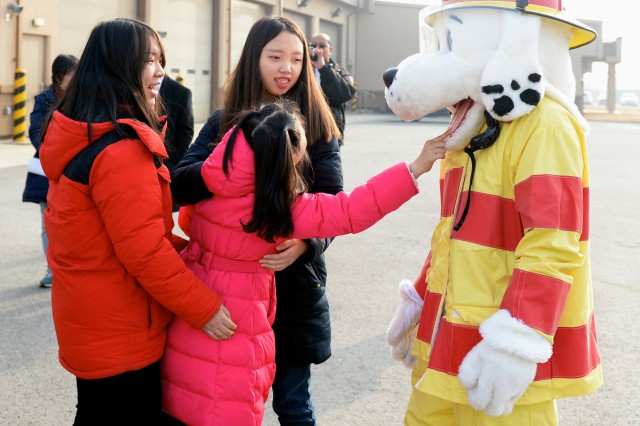 During a visit to a Camp Humphreys, Korea Fire station students from the Neul Hae Rang School and volunteers from the YWCA learned about fire safety and had some fun making new friends.