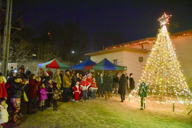 The Christmas tree shines brightly during the Camp Carroll Christmas Tree Lighting  Ceremony. - Christmas Tree Lighting Ceremony Helps Spread Holiday Cheer