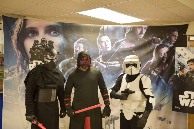 Kylo Ren, Darth Maul and a scout trooper stands in front of the Rogue One Poster during the movie premier at Camp Henry.