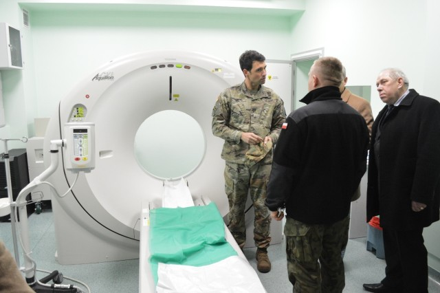 �ARY, Poland -- Capt. Aaron Berg, a 16th Sustainment Brigade medical officer (left), tours the 105 Kresowy Szpital Wojskowy with Dr. Marek Femlak (hidden). The brigade spearheaded an interoperability forum featuring medical leaders from Regional Health Command -- Europe, the 3rd Armored Brigade Combat Team, 4th Infantry Division, and hospital directors from the 105 Kresowy Szpital Wojskowy �ary to discuss the establishment of scalable medical processes in allied countries on Jan. 16. (U.S. Army Photo by 1st Lt. Mark Schneider, 16th Sustainment Brigade Public Affairs Office)