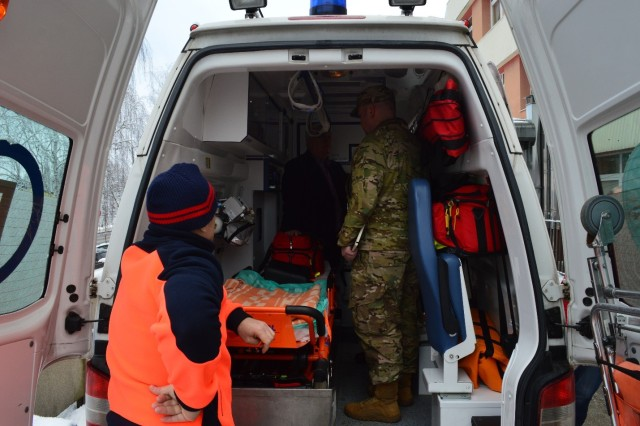 �AGA�, Poland -- Maj. Michael Samuels, 3/4 ABCT surgeon, learns about the layout of a Polish ambulance. The 16th Sustainment Brigade spearheaded an interoperability forum featuring medical leaders from Regional Health Command -- Europe, the 3rd Armored Brigade Combat Team, 4th Infantry Division, and hospital directors from the 105 Kresowy Szpital Wojskowy �ary in order to discuss the establishment of scalable medical processes in allied countries on Jan. 16. (U.S. Army Photo by 1st Lt. Mark Schneider, 16th Sustainment Brigade Public Affairs Office)