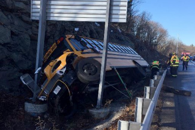 A Massachusetts National Guardsman helped aid 22 children and 2 adults at this accident site where a school bus had overturned Jan. 11 in Waltham, Mass.