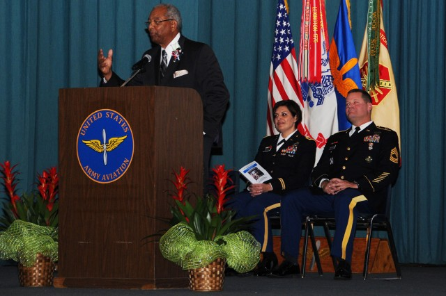 Retired Command Sgt. Maj. James W. Harris Sr., former Fort Rucker Equal Employment Opportunity officer, speaks during the Martin Luther King Jr. Commemorative Program at the post theater Jan. 12.
