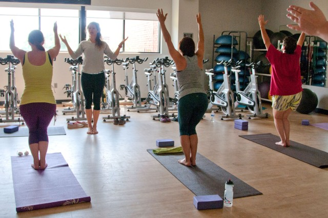 Patrons participate in a previous yoga class at Fortenberry-Colton Physical Fitness Center. Yoga will be among the numerous class offered through Well Beats.