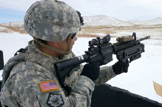 A Soldier from the 4th Engineer Battalion handles an M320 grenade launcher during weapon qualification at Fort Carson, Colorado. Engineers at Picatinny Arsenal have developed an improved pyrotechnic formulation for the infrared illumination cartridge used by the M320 and M203 grenade launchers.