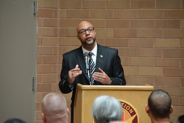 Guest speaker Dr. Isaac Hampton, command historian at U.S. Army South, talks about the life of Dr. Martin Luther King Jr. during Brooke Army Medical Center's MLK observation in the Medical Mall Jan. 18, 2017.