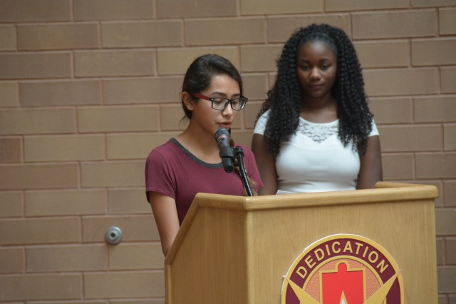 Seleste Cavazos and Avea Walters, Robert G. Cole Middle School and High School students read their essays about Martin Luther King Jr. Jan. 18, 2017 during the MLK observance in the Medical Mall.