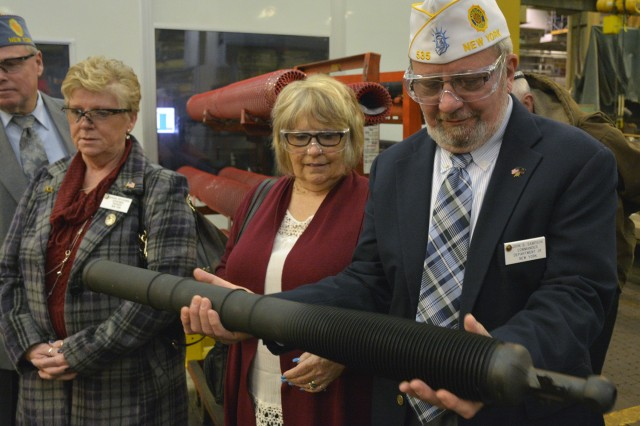 New York state American Legion Department Commander John Sampson checking out the weight of a 60mm mortar tube.