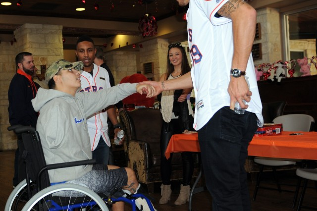 Houston Astros pitcher Joe Musgrove shakes hands with a wounded Soldier while Astros outfielder Tony Kemp looks on during the 2017 Houston Astros Caravan visit to the Warrior and Family Support Center on Jan. 18 at Joint Base San Antonio-Fort Sam Houston. U.S. Army photo by Tim Hipps, Army North Public Affairs