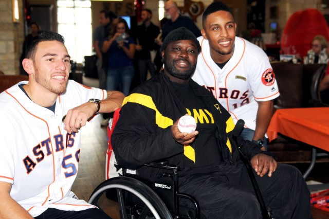 U.S. Army Master Sgt. Damon Watson displays a baseball autographed by Houston Astros pitcher Joe Musgrove (left) and outfielder Tony Kemp (right) on Jan. 18 at the Warrior and Family Support Center on Joint Base San Antonio-Fort Sam Houston, Texas. The visit was part of the 2017 Houston Astros Caravan to connect with fans before reporting to spring training. U.S. Army photo by Tim Hipps, Army North Public Affairs