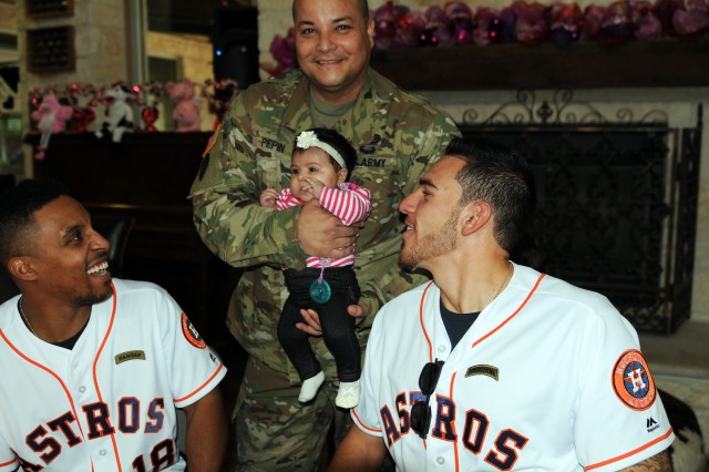 U.S. Army Sgt. 1st Class Charlie Pepin (center) introduces his 2-month-old daughter, Charylie, to Houston Astros outfielder Tony Kemp (left) and pitcher Joe Musgrove (right) on Jan. 18 at the Warrior Family and Support Center on Joint Base San Antonio-Fort Sam Houston, Texas. The visit was part of the 2017 Houston Astros Caravan to connect with fans before reporting to spring training. U.S. Army photo by Tim Hipps, Army North Public Affairs