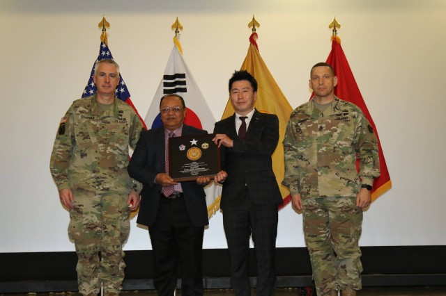 Mr. Lawrence S. Ranches, Maintenance Chief, MSC-K, receives the 19th ESC plaque for the AAME TDA category on Jan. 11.