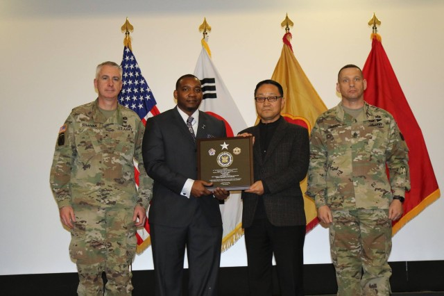 Mr. Chi Hyong Cho, General Supply Technician, DSU, 498th CSSB, receives the 19th ESC plaque for the SEA Level 4B SSA TDA category on Jan. 11.