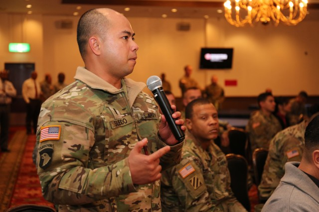 Chief Warrant Officer 3, Salvador Subido, assigned to U.S. Army Aviation Battalion Japan, asks one of the guest speakers a question about entrepreneurship during the Veteran Transition Conference 2017 hosted by the Camp Zama's Transition Service Center Jan. 18 at Camp Zama Community Club. (U.S. Army Photos by Noriko Kudo)