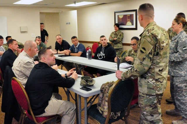 Master Sgt. William J. Schaffhauser III (L) and Sgt. 1st Class Catrina R. Garza, of the U.S. Army Forces Command (FORSCOM) Retention Team give administrative instructions to competitors in the 2017 FORSCOM Career Counselor of the Year Competition, Jan. 23, 2017, at Fort Bragg, N.C.   The event is held annually with winners going on to the Department of the Army Competition in Washington, D.C.