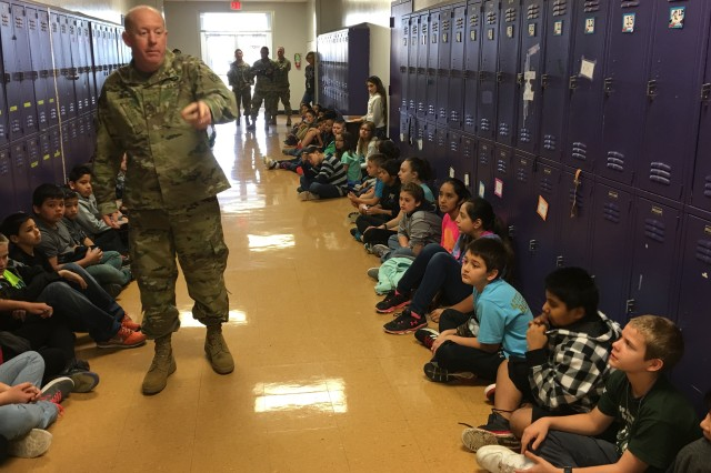Sgt. 1st Class Ryan Neal, a research development test and evaluation non-commissioned officer in Operational Test Command's Maneuver Test Directorate, fields a question during flag etiquette training at Florence Elementary School, Florence Texas, on Jan. 20, 2017.