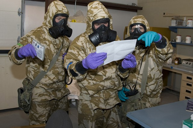 Royal Air Force Gunners from the United Kingdom will return to Dugway to receive more training on chemical and biological defense, and to hone their skills. In this 2016 photo they're reviewing a document from a replicated illicit chemical lab. Photo by Al Vogel, Dugway Public Affairs