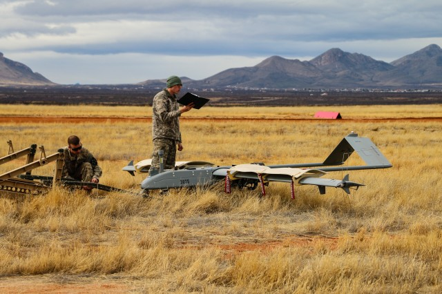 Spc. Joshua Collins, 14th BEB, 2-2 SBCT, relays information as they prepare for flight of the Shadow unmanned aircraft system at Hubbard Landing Zone on Fort Huachuca Jan. 19.  (Photo Credit: Fort Huachuca Public Affairs Lara Poirrier)