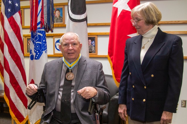 Col(r) Frank Adams (left), retired infantry officer with the U.S. Army, and his wife Joanne Adams (right) after the presentation of the Order of Saint Maurice, Jan. 24 at JBLM. Frank was awarded the Order of Saint Maurice for his role as a mentor to both current and former military officers. It is the highest honors an infantryman can receive from the National Infantry Association. (U.S. Army photo by Staff Sgt. Bryan Dominique)